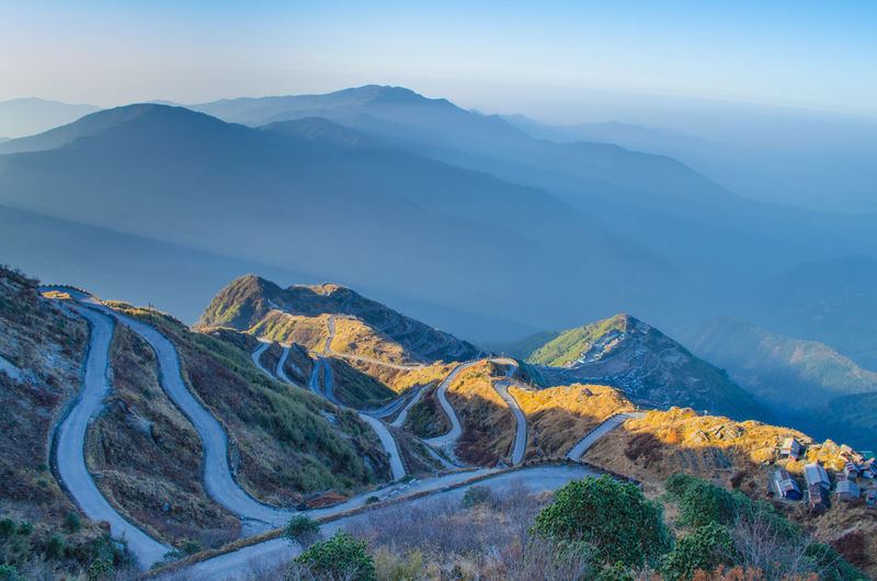 Road Blue Mountain Mountain Range No People Landscape Beauty In Nature Outdoors Nature Day Sky Winding Road Zuluk Oldsilkroute Roadtrip Tranquility Tranquil Scene Beautiful Photography Themes Beauty In Nature Nature Finding New Frontiers