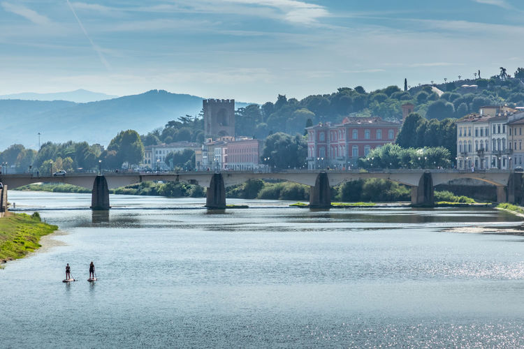 Florence and the river Arno Arno  Arno River Florence, Italy Florence, Italy My Best Travel Photo Water Architecture Built Structure City Nature Building Exterior Sky Mountain Travel Destinations Lake Scenics - Nature Beauty In Nature People Mountain Range Men Outdoors Day Plant Tree Cityscape