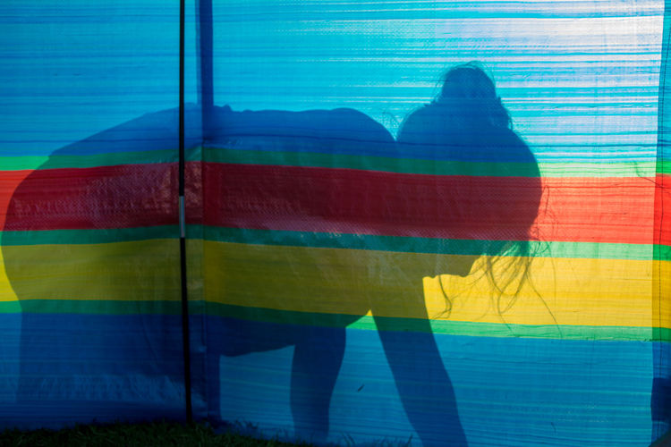 Shadow of girl on colorful fabric