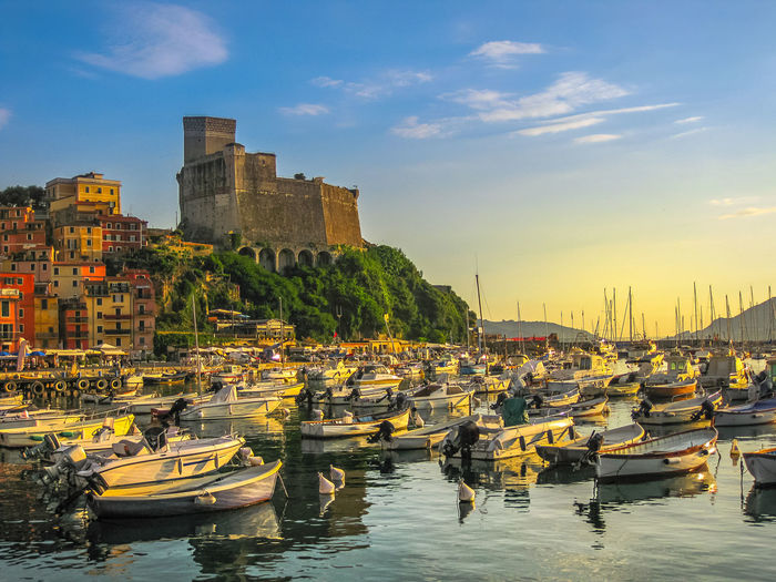 Lerici , Italy- June 5, 2010: Boats of Lerici docked in Lerici port and famous Italian Gulf of Poets. San Giorgio castle on the background at sunset. La Spezia province, Ligurian Coast of Italy. Lerici Italy Beach Sea Sunset Jetty Boats Yacht Aerial View Castle Twilight Water Italian Port Pier Town City San Giorgio San Giorgio Castle Gulf Of Poets Gulf Poets Dock La Spezia Building Built Structure Nautical Vessel Transportation Mode Of Transportation Architecture Sky Building Exterior Nature Moored Harbor Cloud - Sky Waterfront No People Day Outdoors Sailboat
