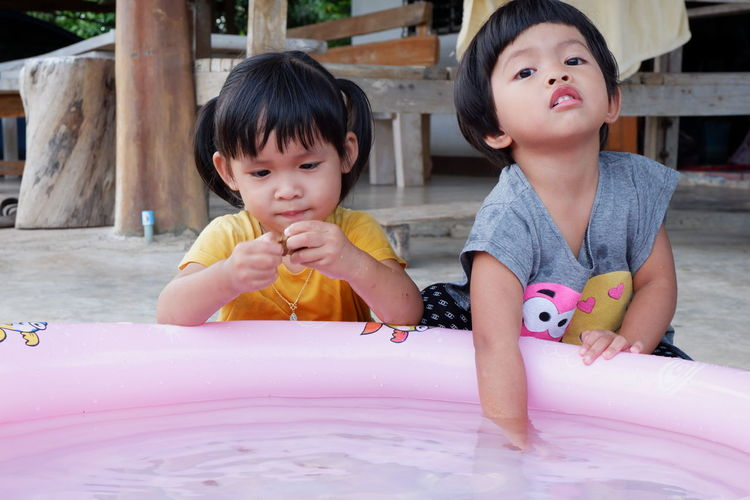 Cute Sisters With Wading Pool