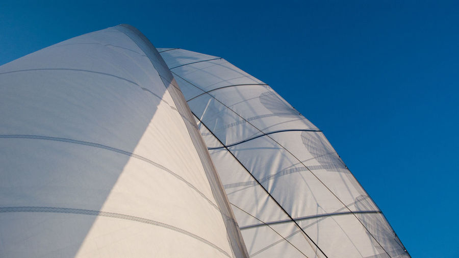 Low Angle View Of Boat Canvas Against Clear Blue Sky