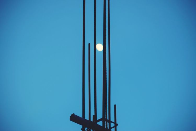 Low angle view of sun through rod