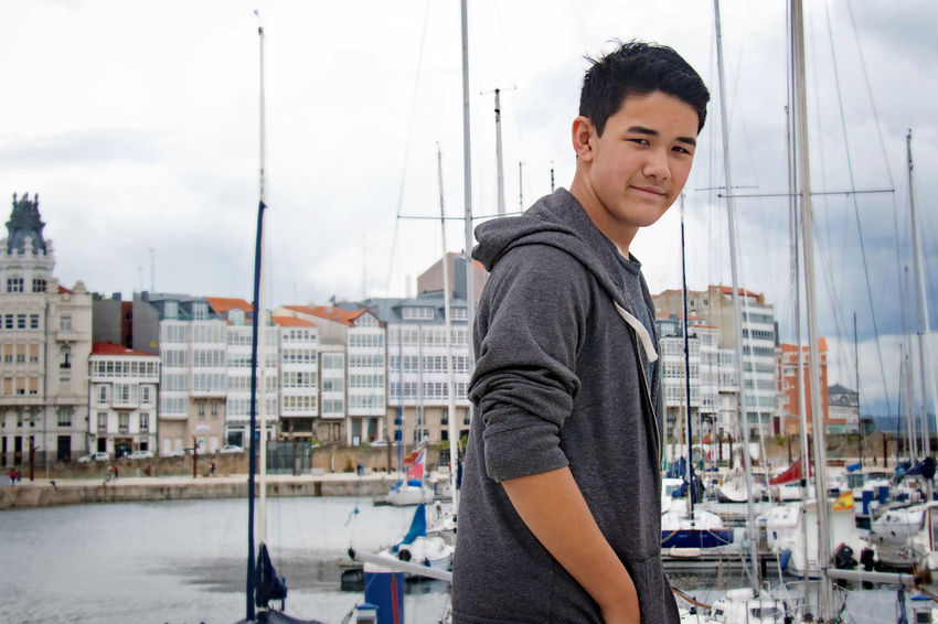 City of Glass Casual Look La Coruña SPAIN Architecture Building Exterior Built Structure Casual Clothing City Day Harbor Leisure Activity Lifestyles Nautical Vessel One Person Outdoors People Portrait Real People Side View Sky Smiling Standing Teenage Boy Young Adult