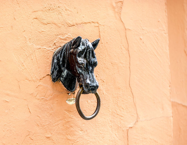 Close-up of door knob on wall