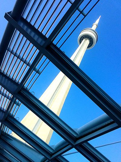 Toronto Canada CN Tower Against Blue Sky modern contemporary architecture bright morning sunshine Convention Centre