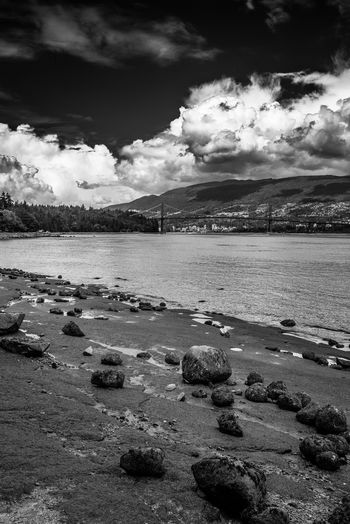 Cloud - Sky Sky Water Tranquil Scene Tranquility Scenics - Nature Nature Rock Beauty In Nature No People Sea Beach Day Solid Rock - Object Outdoors Land Non-urban Scene Pollution Rocky Coastline