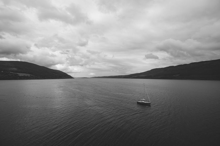 Beauty In Nature Blackandwhite Boat Cloud - Sky Day Mode Of Transport Mountain Mountain Range Nature Nautical Vessel No People Outdoors Sailing Scenics Sea Sky Tranquil Scene Tranquility Transportation Travel Destinations Water Waterfront