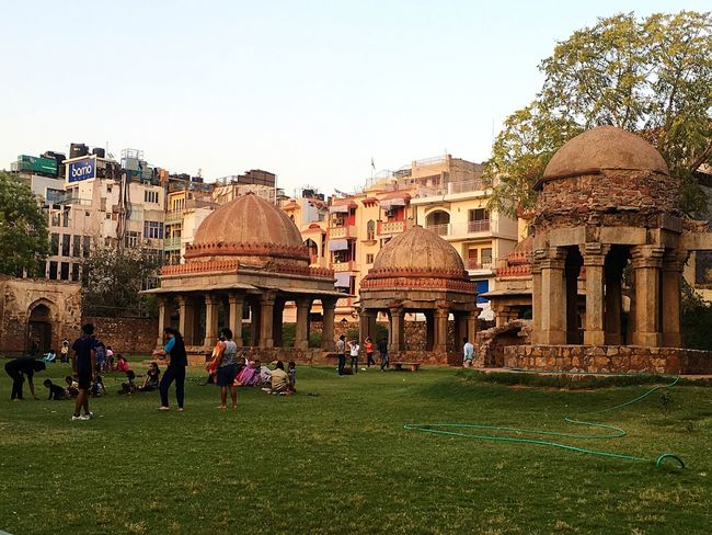 Clear Sky History Large Group Of People Grass Travel Destinations Tourism Day Outdoors Ancient Dome Sky Ancient Civilization People India ASIA Hauzkhas Hauzkhasvillage