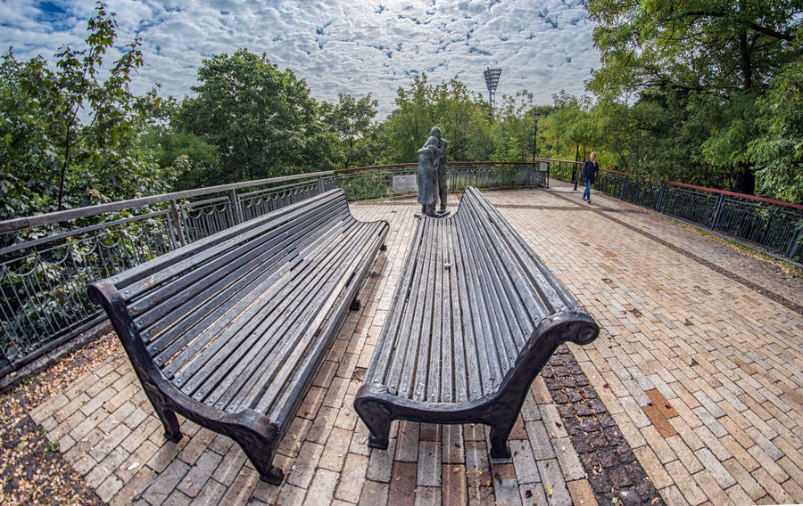 Bench Clouds And Sky Dramatic Dramatic Sky Fisheye Guidelines HDR Outdoors People Prespective Sky Statue Streetphotography Tranquil Scene Travel Photography Ultra Wide Angle Urban Geometry Urbanphotography