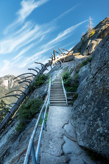 Sequoia National Park, Moro Rock California National Park Sequoia National Park The Great Outdoors - 2018 EyeEm Awards USA Architecture Bridge Built Structure Cloud - Sky Connection Day Direction Formation Leadership Moro Rock Mountain Nature No People Outdoors Railing Rock Rock - Object Rock Formation Sky Solid Staircase Steps And Staircases The Way Forward