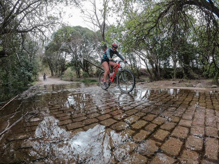 Man riding bicycle on rainy day