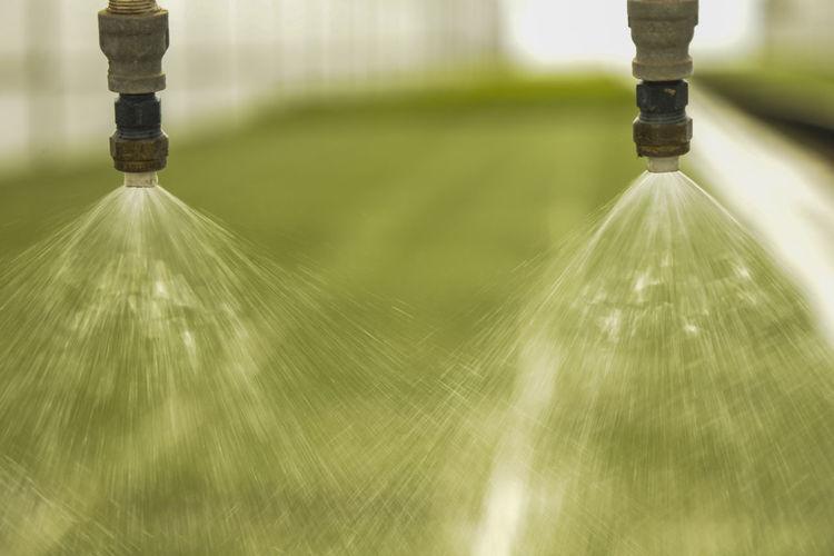 Close-up of sprinkler on field