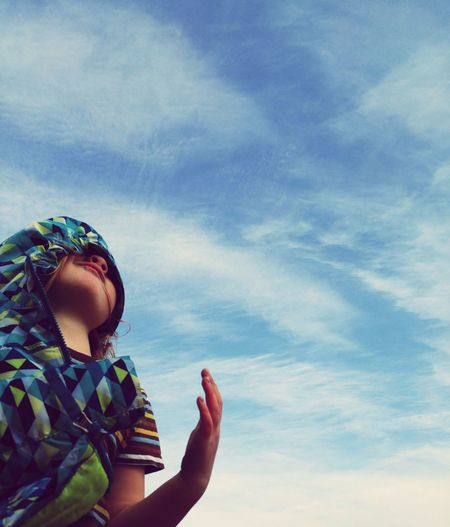 Cropped image of person holding hands against sky