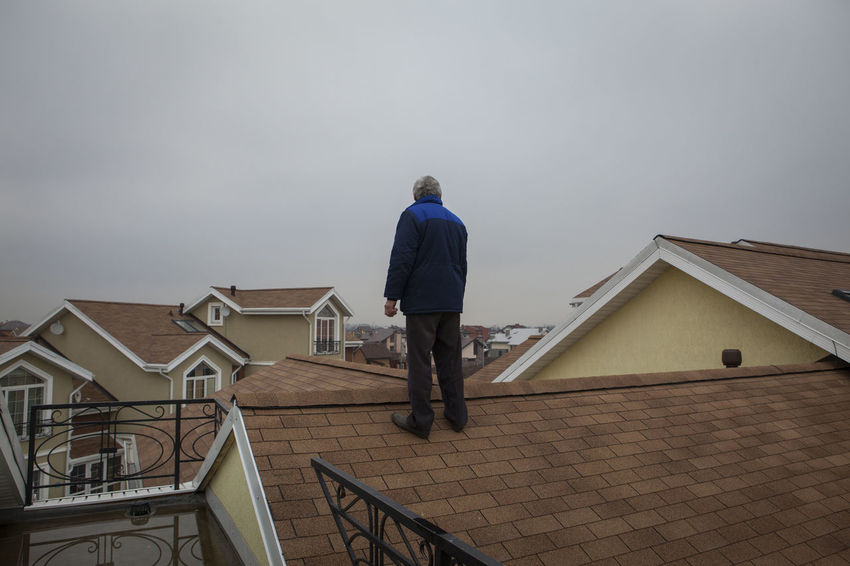 A man standing on a roof in a townhouse village near Moscow Man People People Of EyeEm Roof Russia Russian Street Photography Streetphotography Place Of Heart