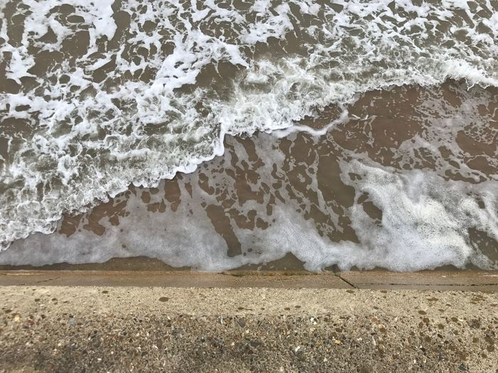 At restless sea in ramsgate. Sea Wave Beach Shore Surf Water Sand Nature Beauty In Nature Day Motion Outdoors Power In Nature Scenics Force Ramsgate Kent