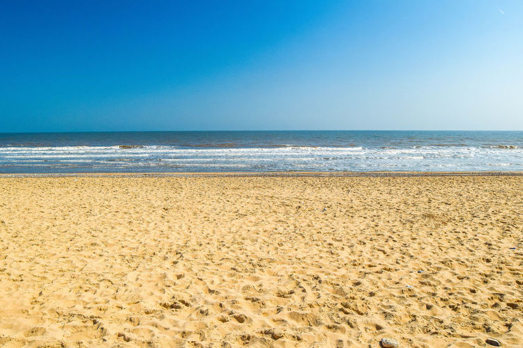 Sea Land Beach Water Sky Horizon Over Water Horizon Sand Beauty In Nature Tranquility Scenics - Nature Tranquil Scene Clear Sky Nature No People Blue Copy Space Day Motion Beach Photography Space For Text Space For Copy
