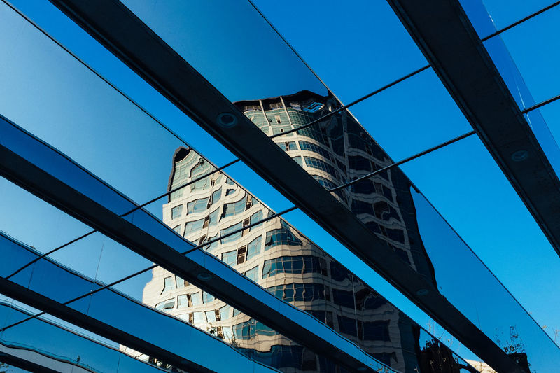 Architecture Blue Bridge - Man Made Structure Building Exterior Built Structure City Clear Sky Connection Day Low Angle View Modern No People Outdoors Sky Skyscraper