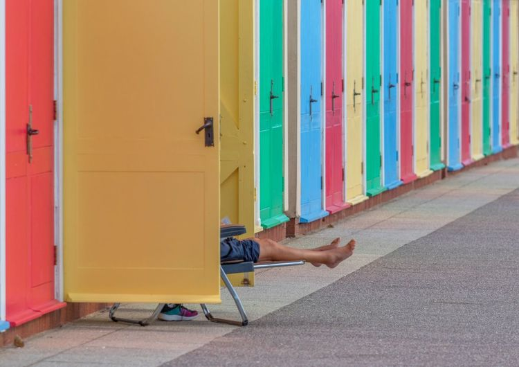 Low section of man in beach hut