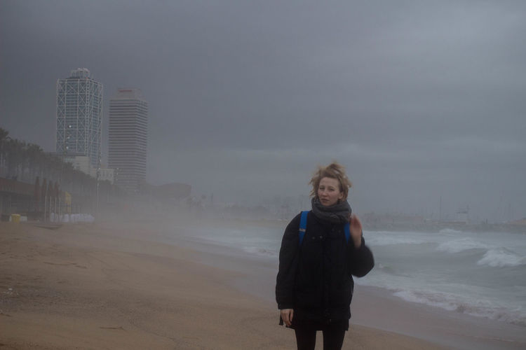 Bad Weather Barcelona Mediterranean  Olympic Park  Rain Rainy Days Storm Stormy Weather Barcelona Winter Beach Blond Girl Blond Hair Clouds Grey Sky One Person Outdoors Portrait Sea Sea Waves Seaside Shoreline Standing Travel Destinations Winter In Barcelona Young Adult