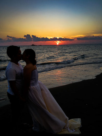 until death do us part. Sunset Silhouette Prenup Lovebirds Water Sea Men Sunset Women Beach Togetherness Wave Couple - Relationship Romantic Sky