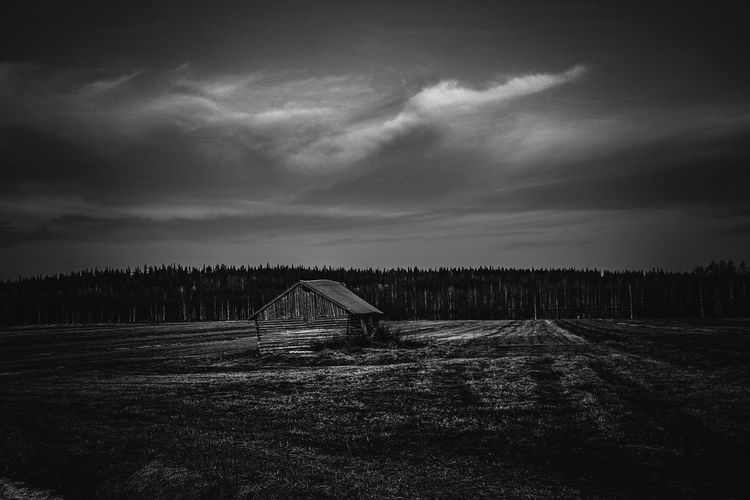 Old agricultural landscape Sky Cloud - Sky Land Tranquil Scene Tranquility Field Nature Landscape Scenics - Nature No People Beauty In Nature Architecture Built Structure Outdoors Forest Building Blackandwhite Photography Finland Barn Old Buildings EyeEm Best Shots EyeEm Selects Taking Photos Lapland