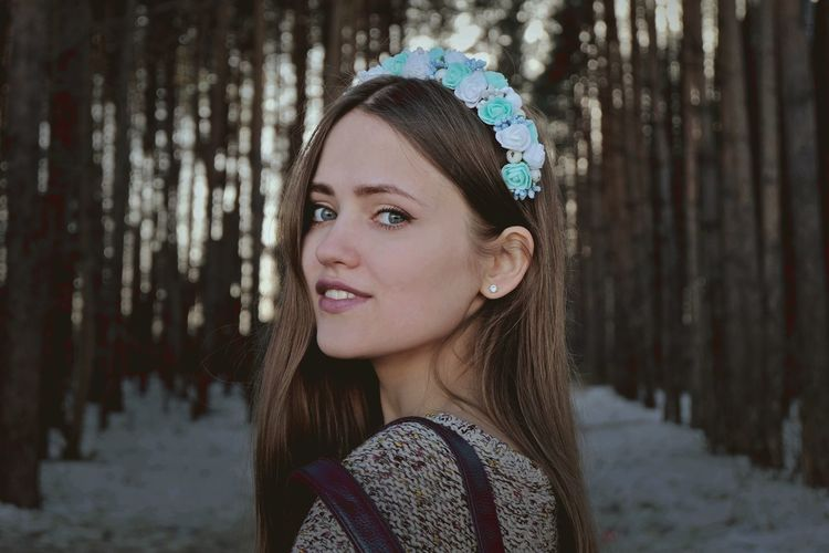 Side View Portrait Of Beautiful Young Woman In Forest