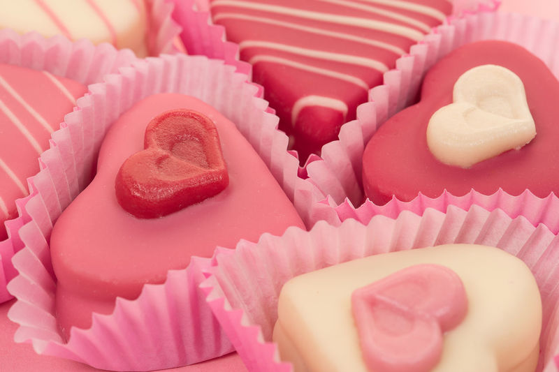 Close-up of a pink heart shaped petit fours cakes seen from the side on a pink background Pink Pink Candy Valentine Valentine's Day  Cupcake Dessert Food Gift Heart Shape Indulgence Petit Fours Sweet Food Temptation