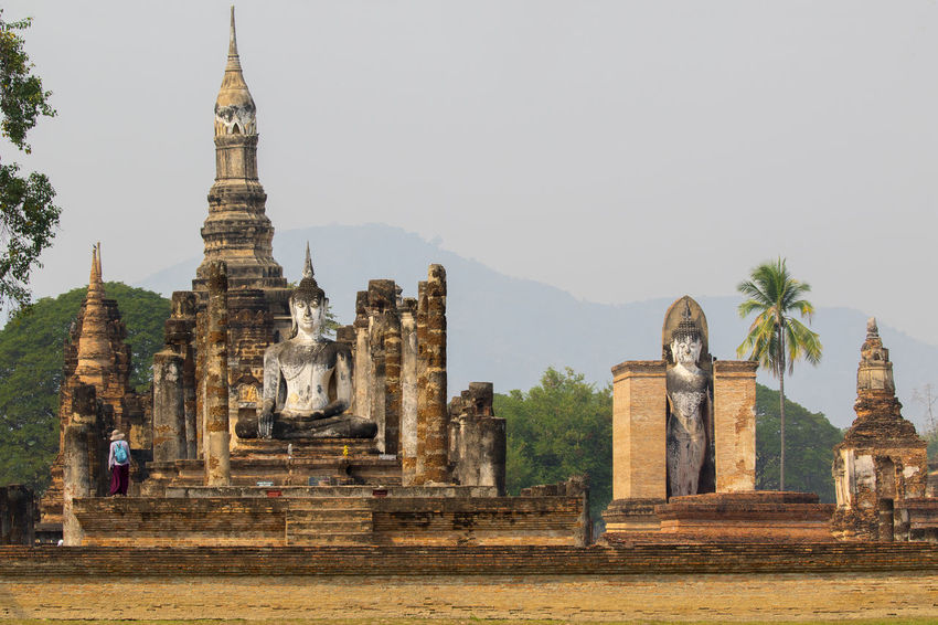 Historical Travel Old Town Ruins Sukhothai Historical Park Thailand Ancient Civilization Architecture Building Exterior Built Structure Day Human Representation No People Old Ruin Outdoors Place Of Worship Religion Sculpture Spirituality Statue Sukhothai Travel Destinations