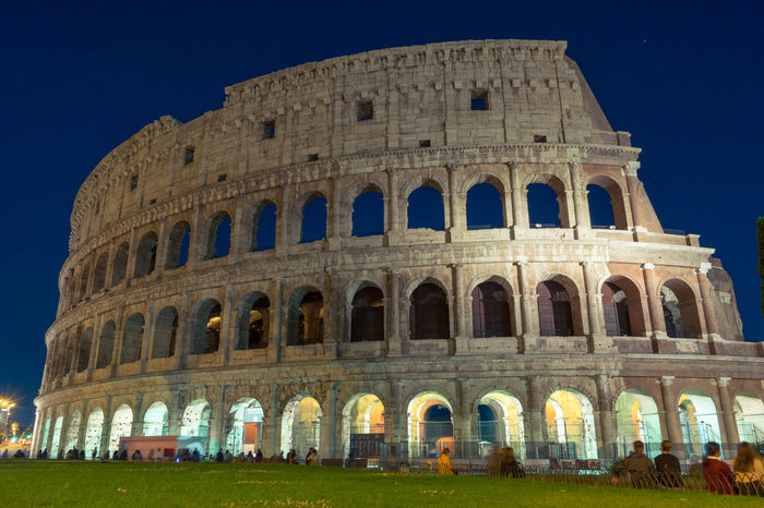 Amphitheater Ancient Civilization Arcade Arch Architecture Building Exterior Built Structure Capital Cities  City Coliseum Culture Famous Place Grass History International Landmark Lawn Leaning Tower Of Pisa Old Ruin Repetition The Past Tourism Travel Travel Destinations UNESCO World Heritage Site Window Your Ticket To Europe Moving Around Rome
