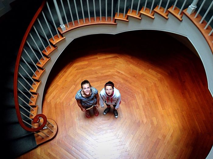 Looking up from down below, snapping pictures from up above... Two People Friendship Architecture Staircase Looking Up Looking Down From Above Museum Teenage Girls Wood Floor Patina Circular Snapping Pics Enjoying Life Simple Moment Togetherness Shadows & Lights Viewpoint New England  Flying High Women Around The World The Secret Spaces