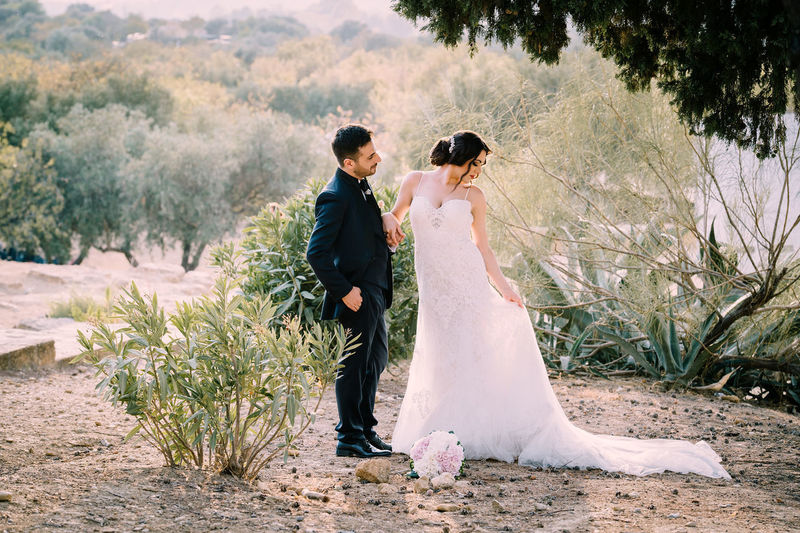 Adult Bride Bridegroom Celebration Couple - Relationship Emotion Event Full Length Life Events Love Married Men Newlywed Outdoors Positive Emotion Two People Wedding Wedding Dress Wife Women Young Adult Young Men Young Women