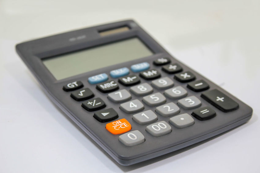 Business Calculator Close-up Corporate Business Dividing Finance Mathematics No People Occupation Office Science Single Object Solar Energy Solar Panel Studio Shot Technology White Background
