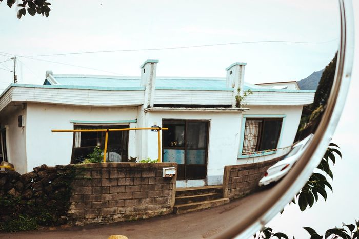 Small house Building Exterior Architecture Built Structure House No People Outdoors Residential Building Jeju JEJU ISLAND  Suburban Suburbs Countryside Korea ASIA Mirrored Mirror Reflection Distorted Mirror Tranquility Small House Village Life Tranquil Scene Reflection Asian Culture Residential Structure