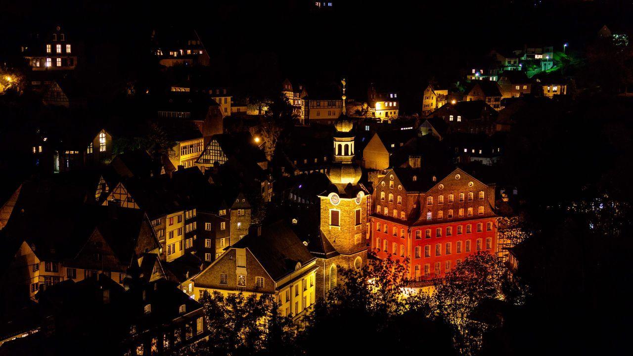 Illuminated Church In Town At Night