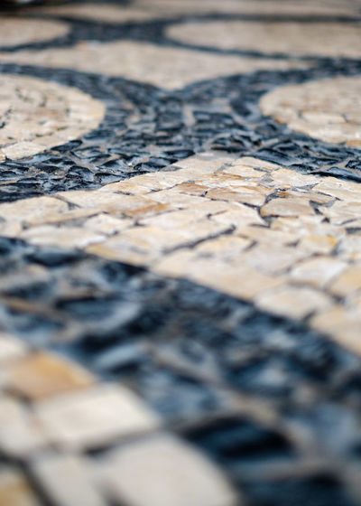 Selective Focus Full Frame Backgrounds Close-up Pattern No People Textured  Textile Land Outdoors Day Creativity Black Color Abstract Extreme Close-up Architecture Tiled Floor Tiled Pavement