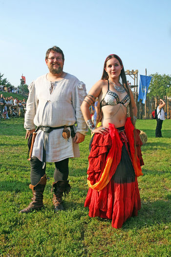 Renaissance Festival,Koprivnica 2016,harem coctumed pair, 8 Contributors Costumes Croatia Day Eu Europe Fair Fancy Field Front View Full Length Grass Harem Koprivnica Looking At Camera Outdoors Renaissance Festival Standing Summer Togetherness Young Adult