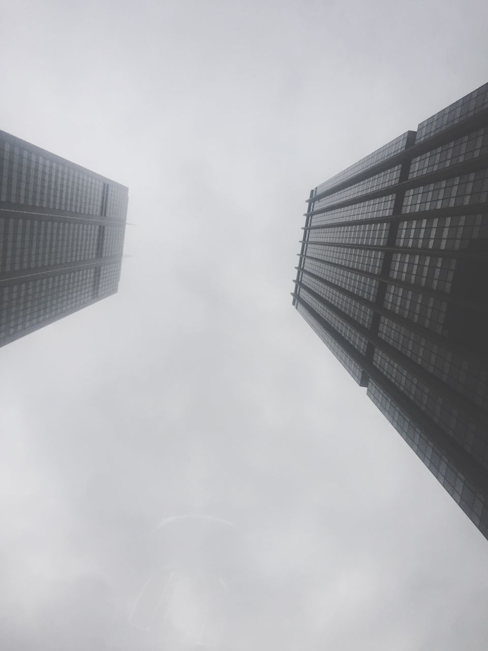 architecture, building exterior, built structure, skyscraper, modern, low angle view, city, sky, tower, outdoors, day, tall, no people, growth, twin