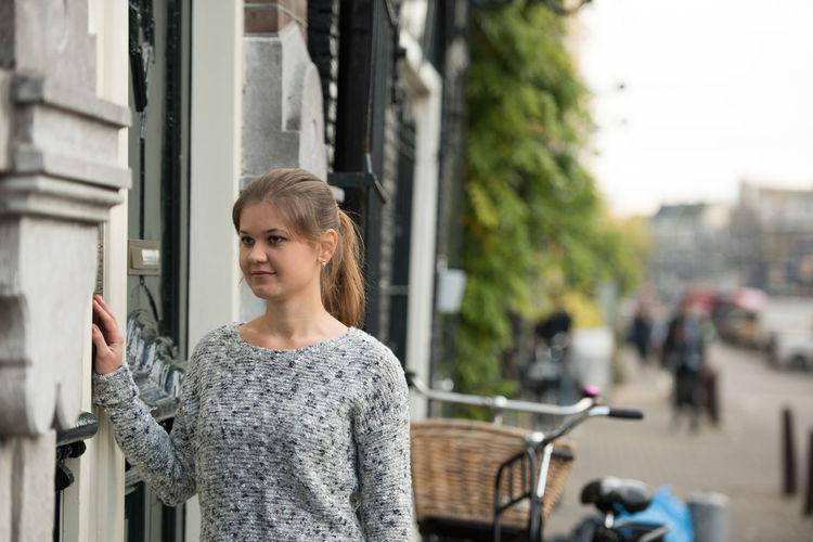 Woman entering code to open door