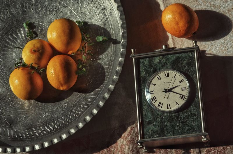 lemons Clock Time Clock Face Fruit Table Close-up Food And Drink Roman Numeral Moon Planetary Moon Egg White Crescent Egg Yolk Orange - Fruit Hour Hand Wall Clock Moon Surface Half Moon Astronomical Clock Moonlight Clock Hand Second Hand Pocket Watch Instrument Of Time Orange Tree Sunny Side Up Eggshell Eclipse Tangerine Fried Egg