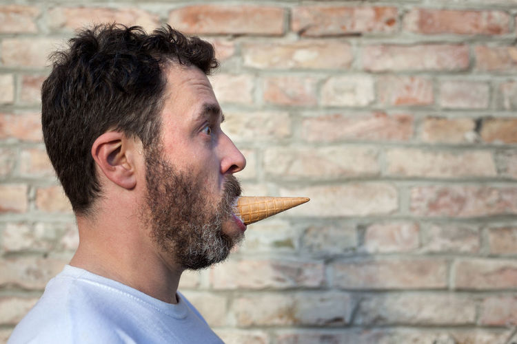 Side view of man eating ice cream