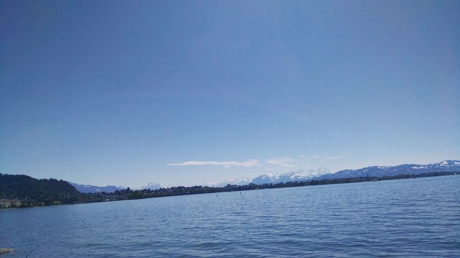 Two People Padelling On Lake Nature Lake Beauty In Nature Lake Of Constance Outdoors Mountain Blue Scenics Clear Sky Landscape Landschaftsaufnahme Cold Temperature Water Sky Day In Front Of Bregenz