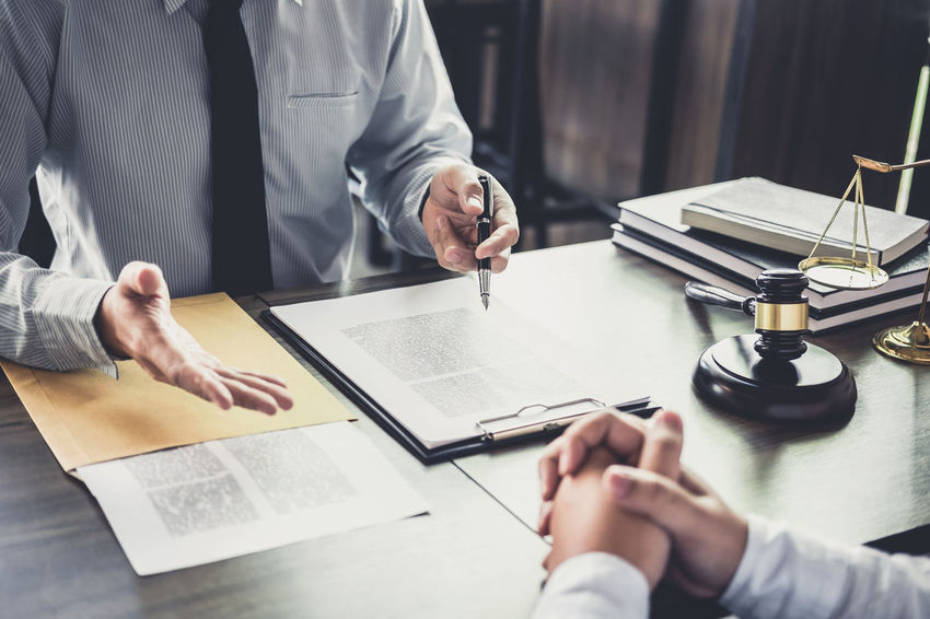 Lawyer Balance Barrister Business Business Person Consultant Counselor Customer  Fairness Gavel Hand Holding Human Hand Indoors  Judge Judgement Justice Legal Legislation Men Occupation Office Paper Verdict Writing