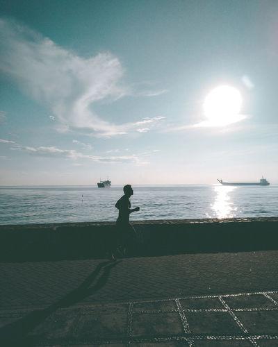 Man jogging by sea