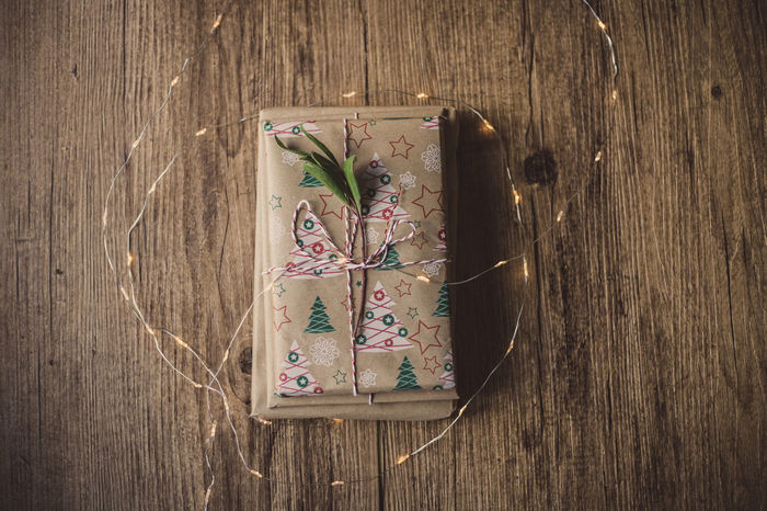 Wrapped gifts on wooden table Christmas Holiday Love Wrap Chritsmas Decoration Gift Paper Wrapped