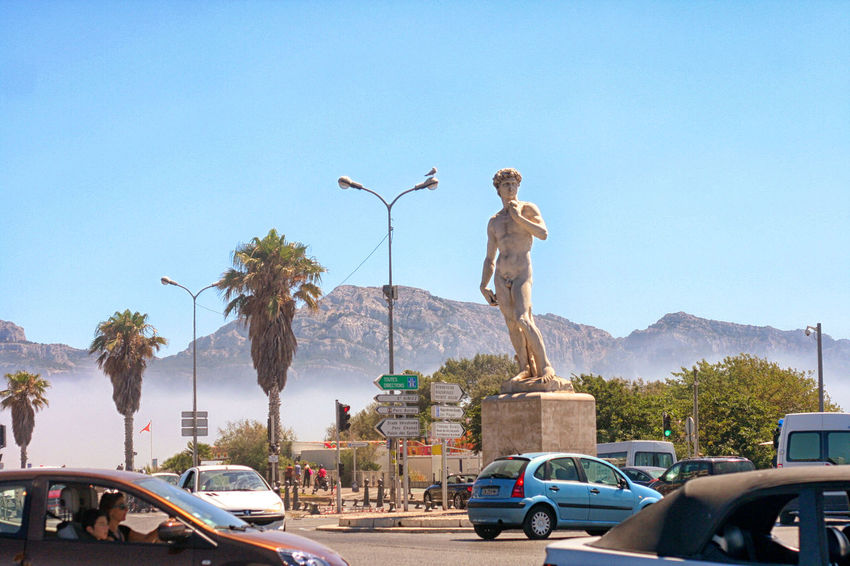 Automobile Blue Circulation Clear Sky David Day Marseille Marseillerebelle Mountain Ocean Breeze Outdoors Rare Moment Sky Statue Sunlight Tourism Travel Destinations Tree