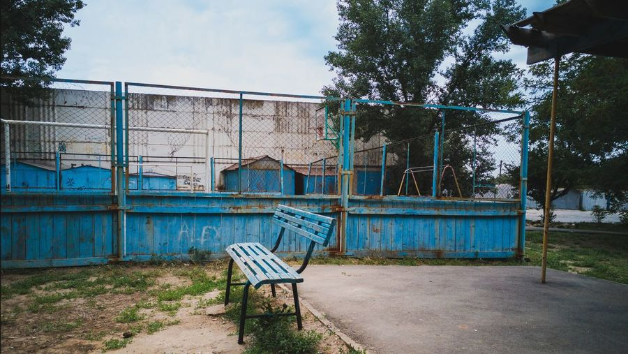 View of abandoned playground against sky