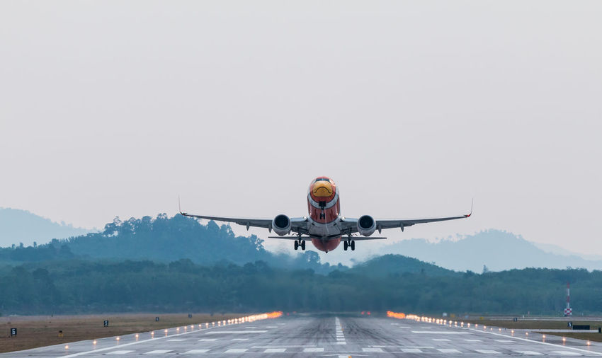 Airplane Flying On Runway Against Sky