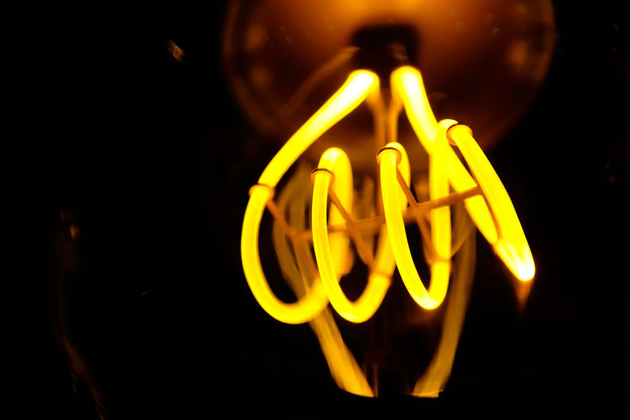 Close up of yellow lighting filament Close-up Electricity  Filament Filament Bulb Filament Light Glowing Gold Colored Illuminated Indoors  Lighting Element Long Exposure Night No People Technology Yellow