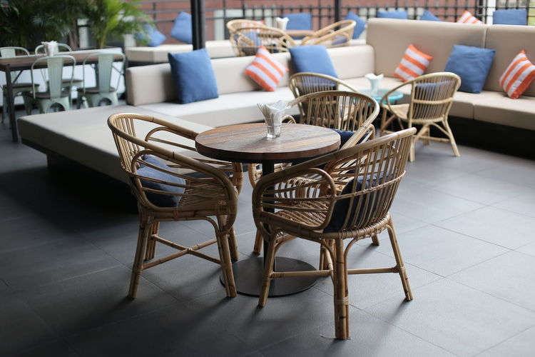 kerusi rotan Absence Arrangement Business Cafe Chair Day Empty Flooring Focus On Foreground Furniture Indoors  Nature No People Restaurant Seat Still Life Table Technology Tiled Floor Wood - Material